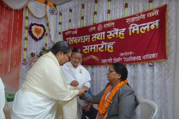 BK Parinita Didi tying Rakhi to Deputy Speaker of Provincial Assembly of Gandaki and Federal Police Unit Office, Senior Superitendant Officer